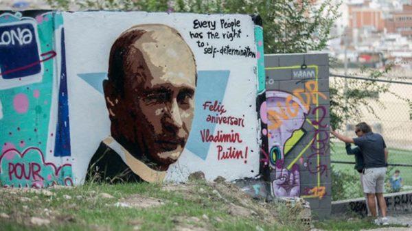Путина поздравили ворованным граффити